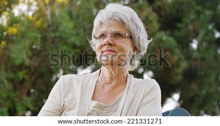Senior woman enjoying the fresh air - stock photo