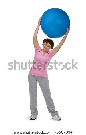 senior woman exercising in gym with fitball - stock photo