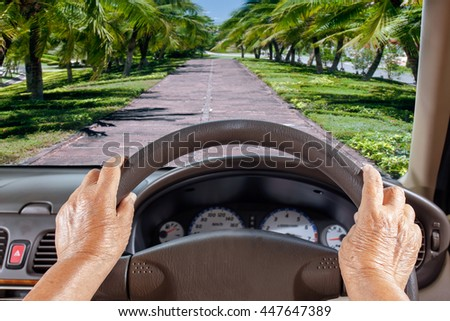 Senior Woman Get Lost Way On Rural Road - stock photo