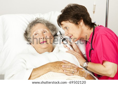 Senior woman gets a medical exam from a nurse in the hospital. - stock photo