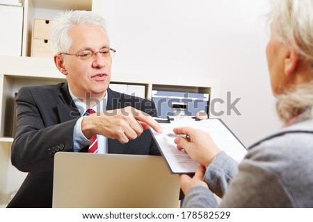 Senior woman getting minutes of consultation from her financial consultant - stock photo