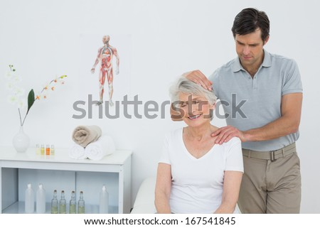 Senior woman getting the neck adjustment done in the medical office