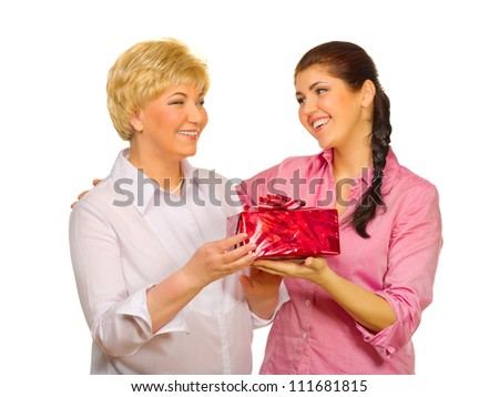 Senior woman giving gift to her daughter isolated - stock photo
