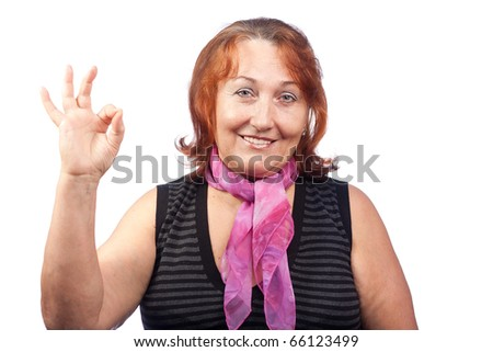 Senior woman giving OK hand sign - stock photo