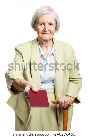 Senior woman giving passport while standing over white - stock photo