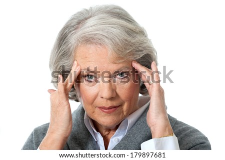 Senior woman has headache isolated on white