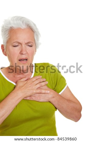 Senior woman having a heart attack and grabbing her chest