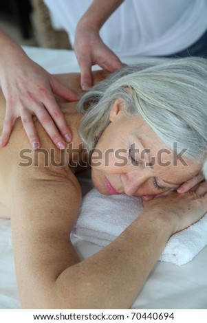 Senior woman having a massage - stock photo