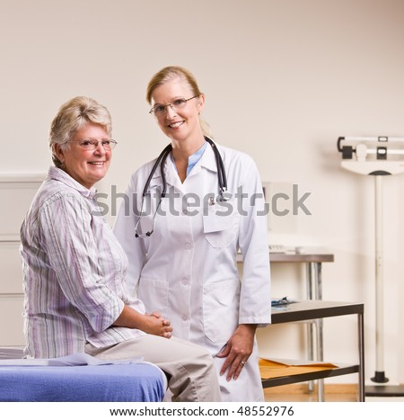 Senior woman having checkup in doctor office - stock photo