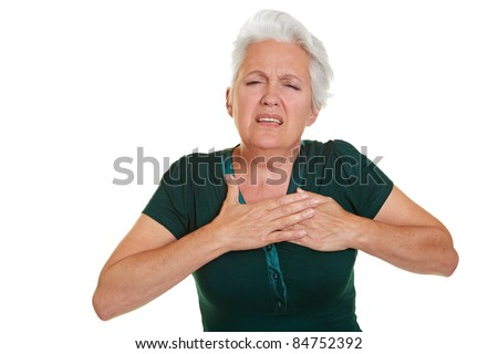 Senior woman having coronary and holding hand to her chest