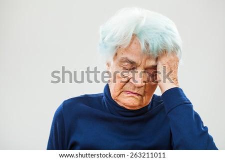 Senior woman having headache - stock photo