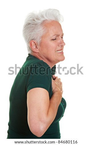 Senior woman having heart pain holding her chest