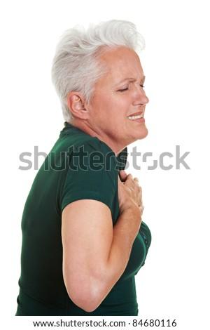 Senior woman having heart pain holding her chest - stock photo