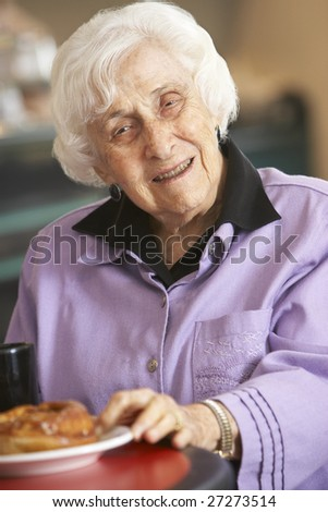 Senior woman having morning tea - stock photo