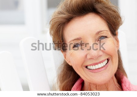 Senior woman head and shoulders - stock photo