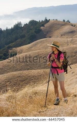Senior woman hiking - stock photo