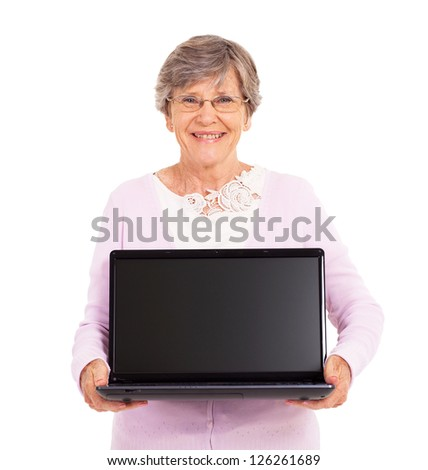 senior woman holding a laptop computer isolated on white - stock photo