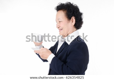 Senior woman holding coffee cup over white background