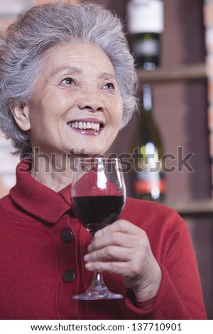 Senior Woman Holding Glass of Wine, Portrait