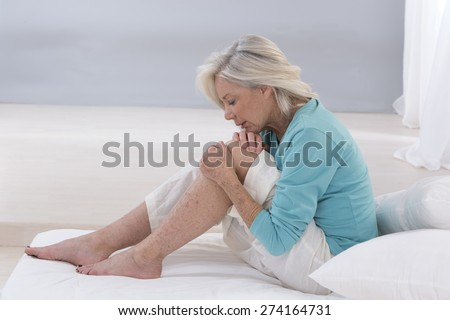 Senior  woman holding the knee with pain  - stock photo