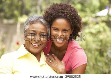 Senior Woman Hugging Adult Daughter - stock photo