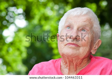 Senior Woman in a Wheelchair Looking up - stock photo