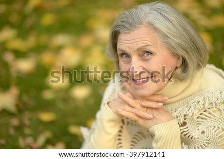senior woman in  autumn park