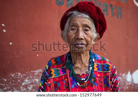 Senior woman in ethnic traditional Latin American dress. Travel background for Guatemala. - stock photo