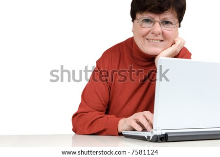 Senior woman in front of a computer. Studio picture. Full isolated.