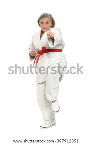 Senior woman in karate pose - stock photo