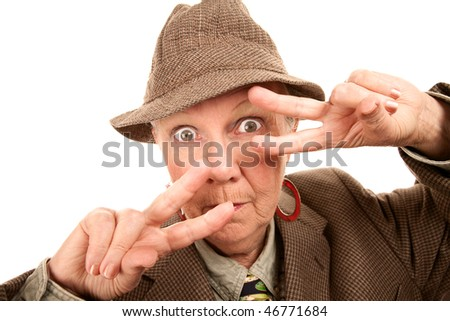 Senior woman in male clothing making fashionable dance hand gesture