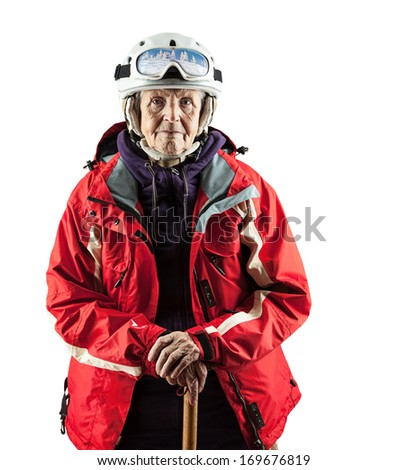 Senior woman in ski jacket and helmet over white. With clipping path. - stock photo