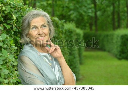 senior woman in summer park - stock photo