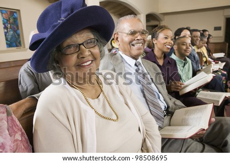 Senior Woman in Sunday Best at Church - stock photo
