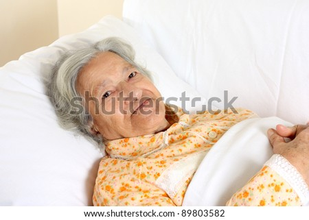 Senior woman in the hospital bed - stock photo
