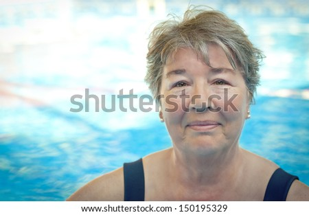 Senior Woman in the Pool - stock photo