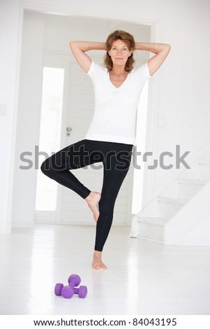 Senior woman in yoga position - stock photo