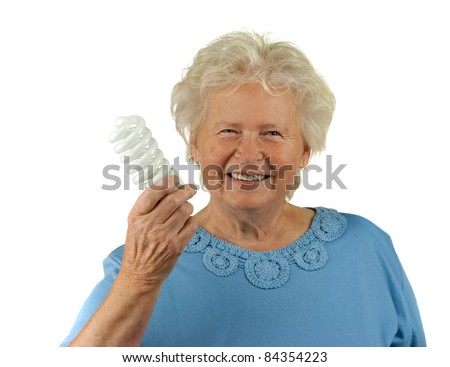 senior woman is holding a energy efficient light - stock photo