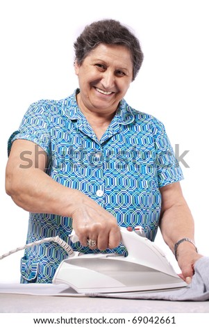 Senior woman isolated on white background, ironing clothes - stock photo