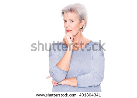 Senior woman ist amazed about something in front of white background - stock photo