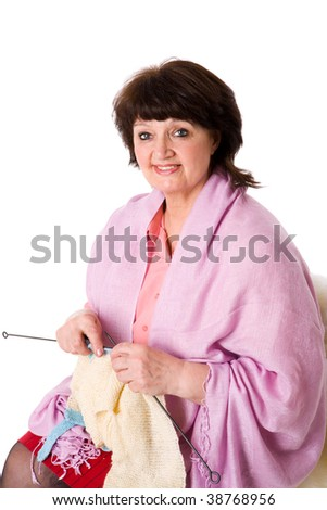 Senior woman Knitting  looking down isolated on white - stock photo