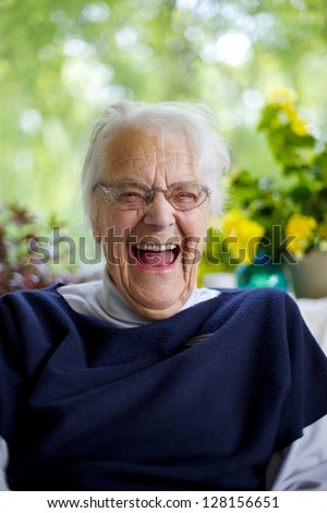 Senior Woman Laughing - stock photo
