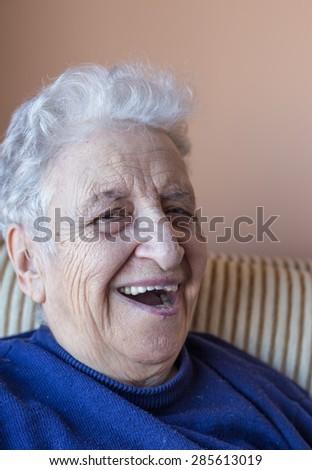 senior woman laughing - stock photo