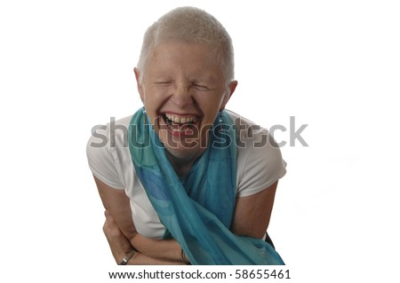 Senior woman laughs spontaneously.