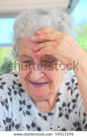 Senior woman leaning on her hand - stock photo