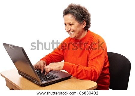 Senior woman learning to use the computer, isolated on white background