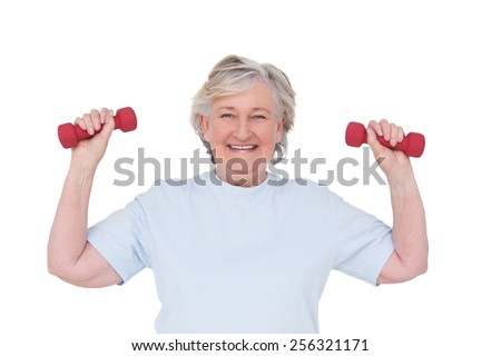 Senior woman lifting hand weights on white background - stock photo