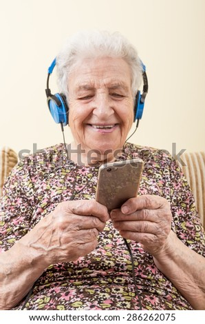 senior woman listening music - stock photo
