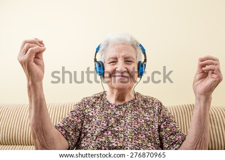 senior woman listening music and dancing