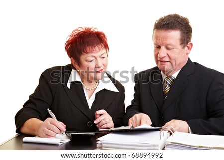 Senior woman listening to a financial adviser